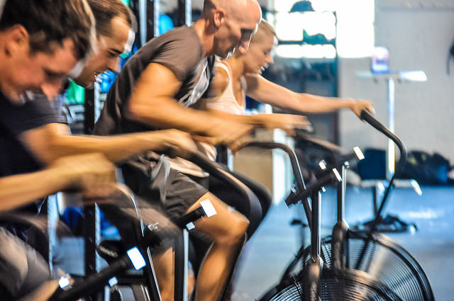 physical therapy assistant schools online traning. Students training on bikes in the gym