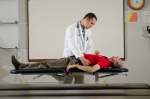 Getting into Physical Therapy School with Low GPA - A student performing a physical exam