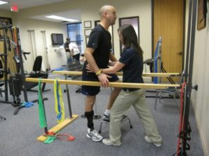 Physical Therapist Assistant assisting a patient during therapy